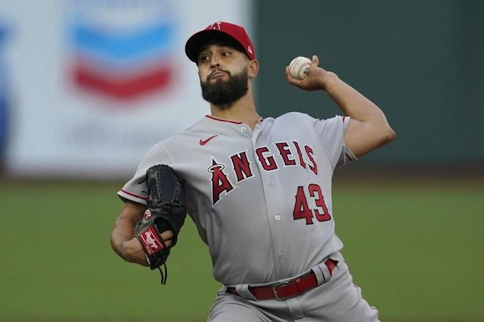 """Angels pitcher Patrick Sandoval throws against the San Francisco Giants on Aug. 19. <span class=""""copyright"""">(Jeff Chiu / Associated Press)</span>"""