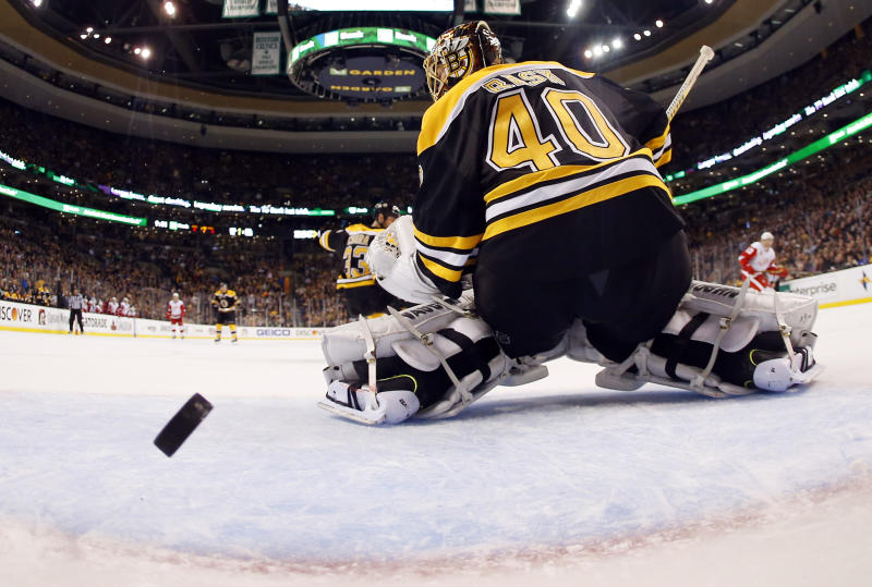 In this photo taken with a fish eye lens, Boston Bruins goalie Tuukka Rask can't stop a goal by Detroit Red Wings' Pavel Datsyuk's during the third period of Detroit's 1-0 win in Game 1 of a first-round NHL playoff hockey series, in Boston on Friday, April 18, 2014. (AP Photo/Winslow Townson)