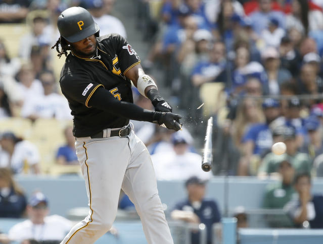 Pittsburgh Pirates' Josh Bell hits a broken-bat RBI-single to score Melky Cabrera against the Los Angeles Dodgers during the eighth inning of a baseball game in Los Angeles, Sunday, April 28, 2019. (AP Photo/Alex Gallardo)