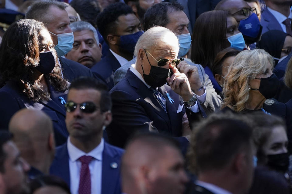 Former first lady Michelle Obama, President Joe Biden and first lady Jill Biden attend a ceremony marking the 20th anniversary of the Sept. 11, 2001, terrorist attacks at the National September 11 Memorial and Museum in New York, Saturday, Sept. 11, 2021. (AP Photo/Evan Vucci)