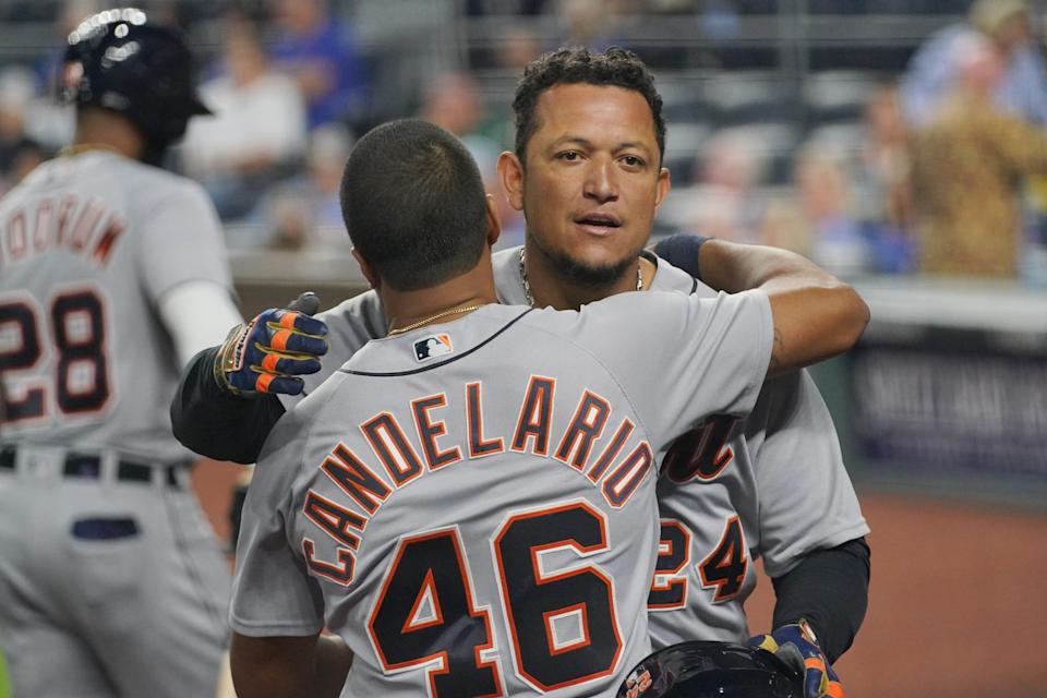 Detroit Tigers first baseman Miguel Cabrera (24) celebrates with third baseman Jeimer Candelario (46) after hitting a grand slam in the seventh inning against the Kansas City Royals at Kauffman Stadium in Kansas City, Missouri, on Friday, May 21, 2021.