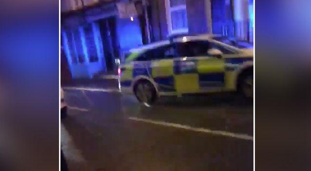 The police car is seen skidding before doing a 180 degree turn to stop. Source: Facebook
