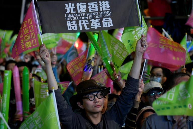 A smattering of the financial hub's flag and pro-demonstration slogans have now become commonplace at Tsai Ing-wen's rallies