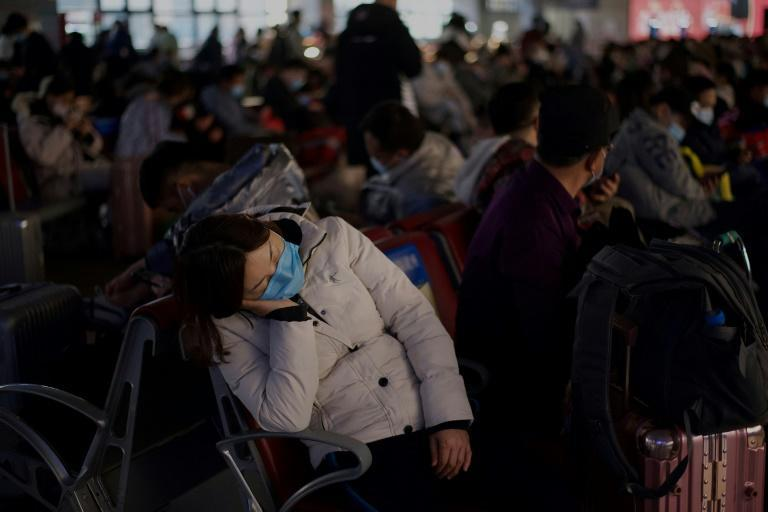 In addition to arduous journeys home, China's migrant workers must contend with coronavirus restrictions that make Lunar New Year travel difficult