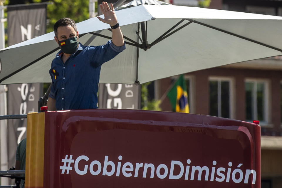 Leader of far right party Vox Santiago Abascal waves during a drive-in protest organised by Spain's far-right party Vox against the Spanish government's handling of the nation's coronavirus outbreak in Madrid, Spain Saturday, May 23, 2020. . (AP Photo/Manu Fernandez)