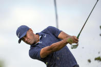 Tony Finau tees off on the fourth hole during the first round of the 3M Open golf tournament in Blaine, Minn., Thursday, July 23, 2020. (AP Photo/Andy Clayton- King)