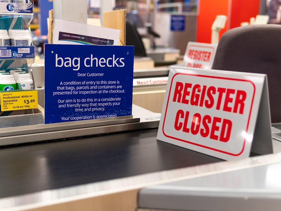 """A """"register closed"""" sign sits on an Aldi checkout line."""