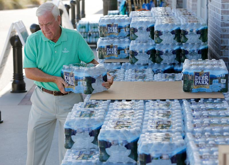 Larry Pierson purchases bottled water from the Harris Teeter grocery store in preparation for Hurricane Florence in Isle of Palms on Monday.