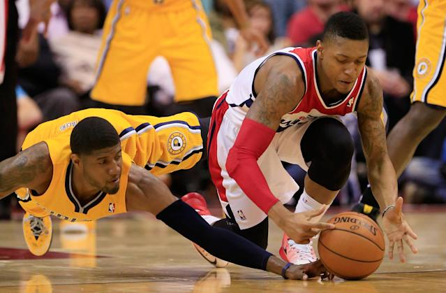 WASHINGTON, DC - MAY 09: Paul George #24 of the Indiana Pacers and Bradley Beal #3 of the Washington Wizards go after a loose ball during the first half of Game 3 of the Eastern Conference Semifinals during the 2014 NBA Playoffs at Verizon Center on May 9, 2014 in Washington, DC. NOTE TO USER: User expressly acknowledges and agrees that, by downloading and or using this photograph, User is consenting to the terms and conditions of the Getty Images License Agreement. (Photo by Rob Carr/Getty Images)