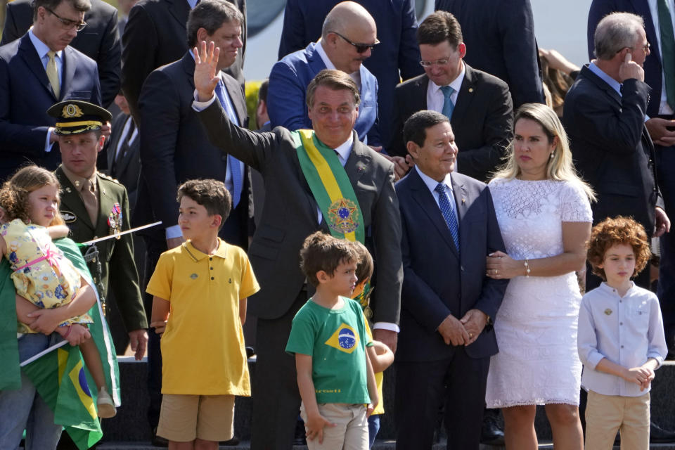 Brazilian President Jair Bolsonaro waves to supporters at the start of a flag raising ceremony on Independence Day at Alvorada Palace presidential residence in Brasilia, Brazil, Tuesday, Sept. 7, 2021. (AP Photo/Eraldo Peres)
