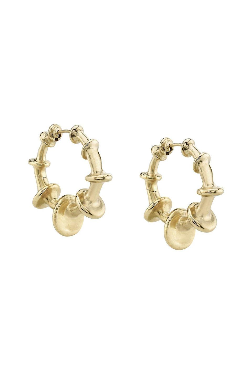 """<p><strong>Vram</strong></p><p>brokenenglishjewelry.com</p><p><strong>$2400.00</strong></p><p><a href=""""https://brokenenglishjewelry.com/products/vm-chrona-hoops-2"""" rel=""""nofollow noopener"""" target=""""_blank"""" data-ylk=""""slk:Shop Now"""" class=""""link rapid-noclick-resp"""">Shop Now</a></p><p>Gold hoops do not have to be boring! Refresh your circulation of pieces with an architectural pair from Vram.</p>"""