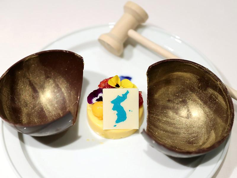 The dessert in question: a tropical mango mousse that features a map including islands contested by Japan: EPA