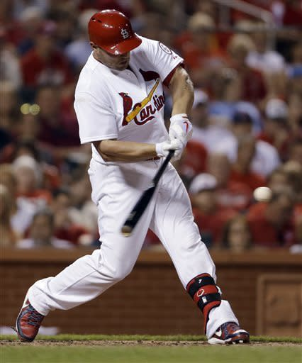 St. Louis Cardinals' Matt Holliday hits a solo home run during the sixth inning of a baseball game against the Kansas City Royals on Wednesday, May 29, 2013, in St. Louis. (AP Photo/Jeff Roberson)