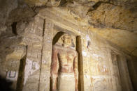 One of the discovered tombs at the Saqqara archaeological site is shown, 30 kilometers (19 miles) south of Cairo, Egypt, Saturday, Oct. 3, 2020. Egypt says archaeologists have unearthed about 60 ancient coffins in a vast necropolis south of Cairo. The Egyptian Tourism and Antiquities Minister says at least 59 sealed sarcophagi with mummies inside were found that had been buried in three wells more than 2,600 years ago. (AP Photo/Mahmoud Khaled)