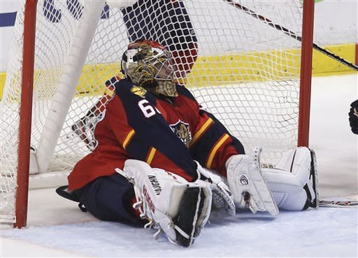 Florida Panthers goalie Jose Theordore sits on the ice after allowing a Winnipeg Jets' goal during the second period of an NHL hockey game in Sunrise, Fla., Tuesday, April 3, 2012. (AP Photo/J Pat Carter)