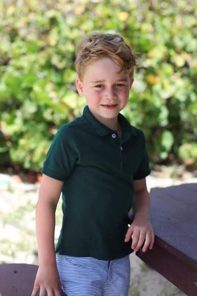 LONDON — Kensington Palace has released three new photographs before Prince George's birthday.The future king turns 6 on Monday. It's become a tradition for the palace to release snapshots taken by his mother Kate, the Duchess of Cambridge.In two of the pictures George is seen with a big smile as he wears an English soccer jersey. The third shows him on a family holiday.George is a great-grandson of Queen Elizabeth II. He is third in line for the throne behind his grandfather Prince Charles and his father Prince William and is the oldest of William's three children.The Associated Press
