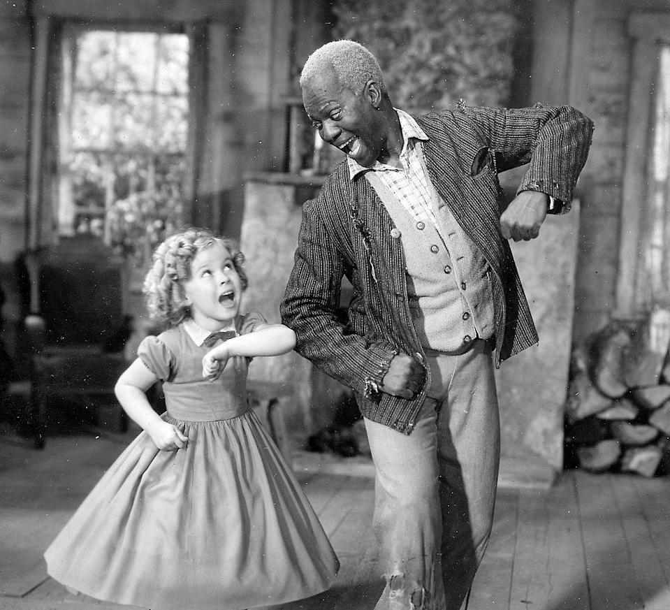 """<p>Shirley Temple performing with Bill """"Mr. Bojangles"""" Robinson on the set of <em>The Little Colonel</em>.</p>"""
