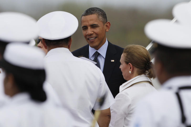 President Barack Obama is greeted at the airport as he arrives to Cartagena, Colombia, Friday April 13, 2012. Obama is in Cartagena to attend the sixth Summit of the Americas. (AP Photo/Carolyn Kaster)