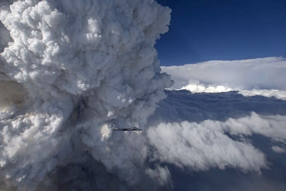 An F-15C fighter jet captured an image of a giant pyrocumulus cloud rising above a wildfire in northern California.