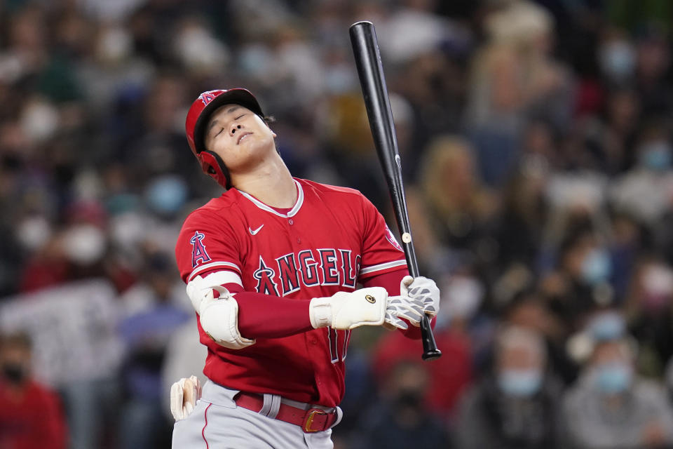 Los Angeles Angels' Shohei Ohtani reacts after striking out swinging to end then top of the seventh inning of a baseball game against the Seattle Mariners, Sunday, Oct. 3, 2021, in Seattle. (AP Photo/Elaine Thompson)