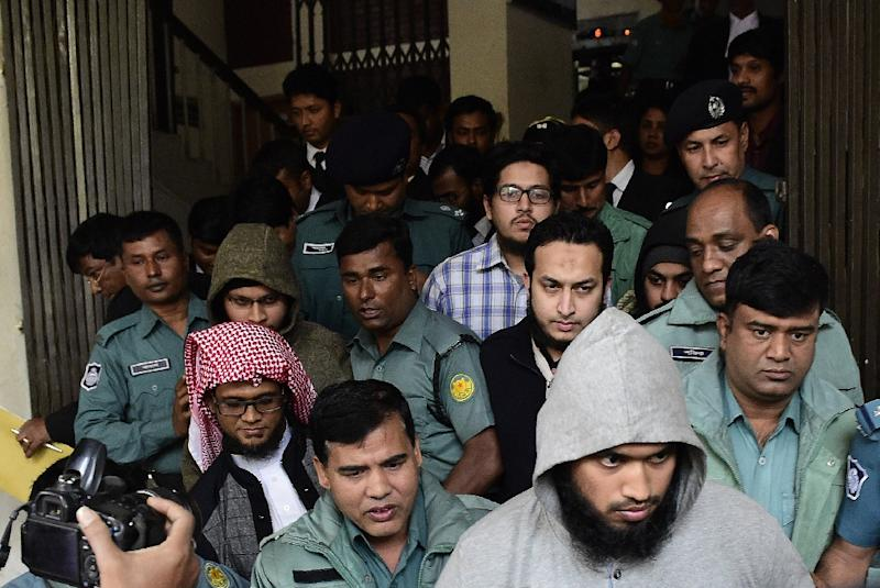 Bangladesh police officials escort some of those accused in the murder of blogger and secular activist Ahmed Rajib Haider following a verdict at a court in Dhaka on December 31, 2015 (AFP Photo/Munir Uz Zaman)