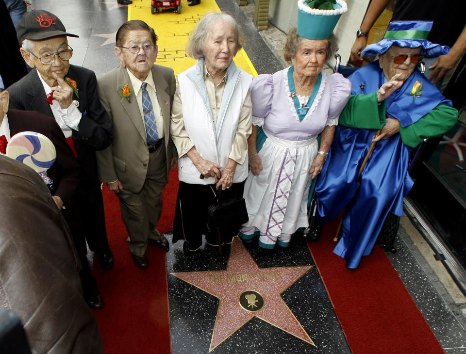 """The Munchkins from """"The Wizard of Oz"""" receive a star on the Hollywood Walk of Fame at Grauman's Chinese Theatre, site of  """"The Wizard of Oz's"""" 1939 premiere, in Los Angeles Tuesday, Nov. 20, 2007. The Munchkins from left: Mickey Carroll, the Town Crier; Karl Slover, the Main Trumpeter; Ruth Duccini, a Munchkin villager; Margaret Pelligrini, the """"sleepyhead"""" Munchkin and Meinhardt Raabe, the coroner. (AP Photo/Damian Dovarganes)"""