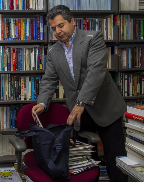 Dr. Najib Ghadbian packs his things in preparation for being named a Syrian opposition representative for the United States. Ghadbian will be taking a leaving of absence from the University of Arkansas until September. (AP Photo/Gareth Patterson)