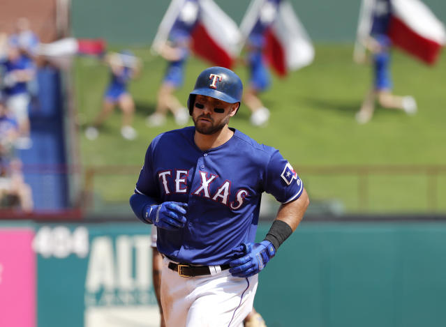 Texas Rangers' Joey Gallo rounds the bases after hitting a two-run home run off of Kansas City Royals' Homer Bailey in the fourth inning of a baseball game in Arlington, Texas, Saturday, June 1, 2019. The shot also scored Hunter Pence. (AP Photo/Tony Gutierrez)