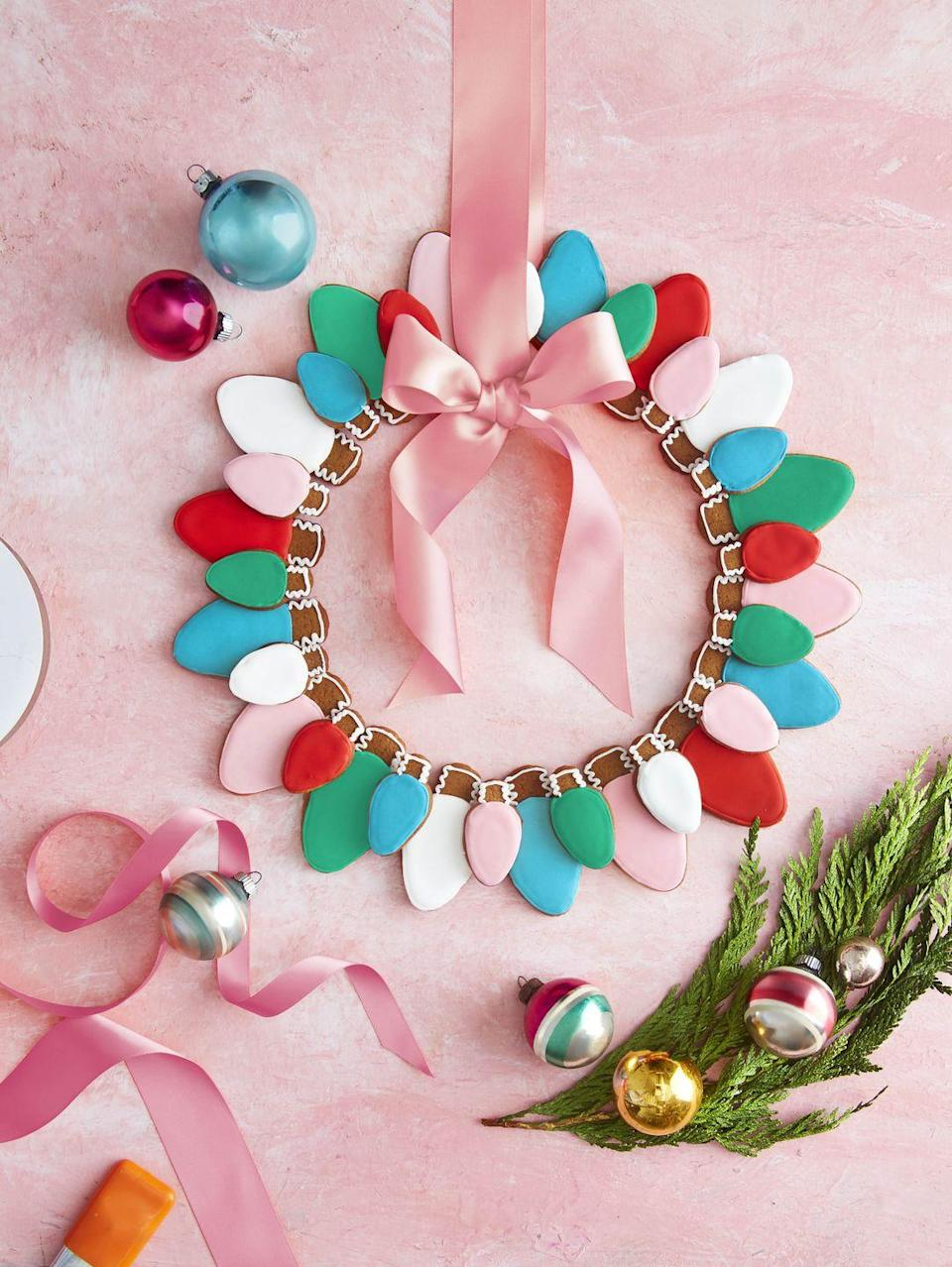 """<p>Fashion homemade Christmas bulb gingerbread cookies into the shape of a wreath and gift with a tag reading, """"Hope your season<br>is merry and bright.""""</p><p><strong><a href=""""https://www.countryliving.com/food-drinks/a34331369/christmas-light-gingerbread-cookies-recipe/"""" rel=""""nofollow noopener"""" target=""""_blank"""" data-ylk=""""slk:Get the recipe"""" class=""""link rapid-noclick-resp"""">Get the recipe</a>.</strong></p><p><a class=""""link rapid-noclick-resp"""" href=""""https://www.amazon.com/Christmas-Light-Bulb-Cookie-Cutter/dp/B08D7F2N8X/ref=sr_1_2_sspa?tag=syn-yahoo-20&ascsubtag=%5Bartid%7C10050.g.645%5Bsrc%7Cyahoo-us"""" rel=""""nofollow noopener"""" target=""""_blank"""" data-ylk=""""slk:SHOP COOKIE CUTTERS"""">SHOP COOKIE CUTTERS</a></p>"""