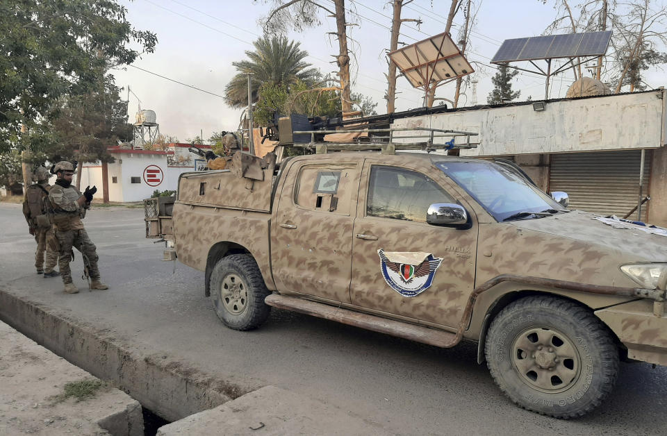 Afghan Special forces patrol a deserted street during fighting with the Taliban, in Lashkar Gah, Helmand province, southern Afghanistan, Tuesday, Aug. 3, 2021. The Taliban pressed ahead with their advances in southern Afghanistan on Tuesday, capturing nine out of 10 districts of the Helmand provincial capital, residents and officials said. The fall of Lashkar Gah would be a major turning point in the offensive the Taliban have waged over the past months as U.S. and NATO forces complete their pullout from the war-torn country. (AP Photo/Abdul Khaliq)