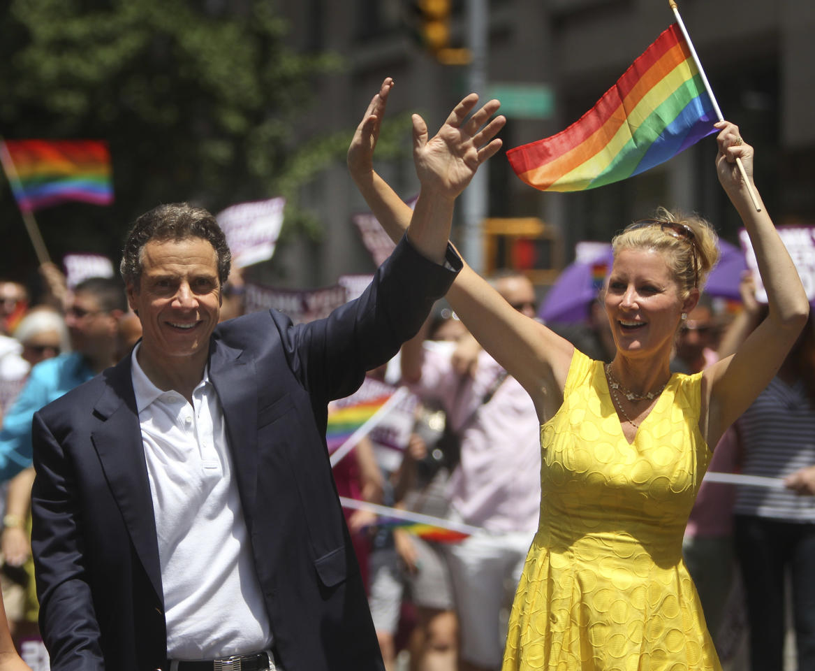 New York Governor Andrew Cuomo and his girlfriend Sandra Lee wave while marching in the Gay Pride Parade in New York, Sunday, June 24, 2012. The parade was held one year to the day of same-sex marriage being legalized in New York state. (AP Photo/Seth Wenig)