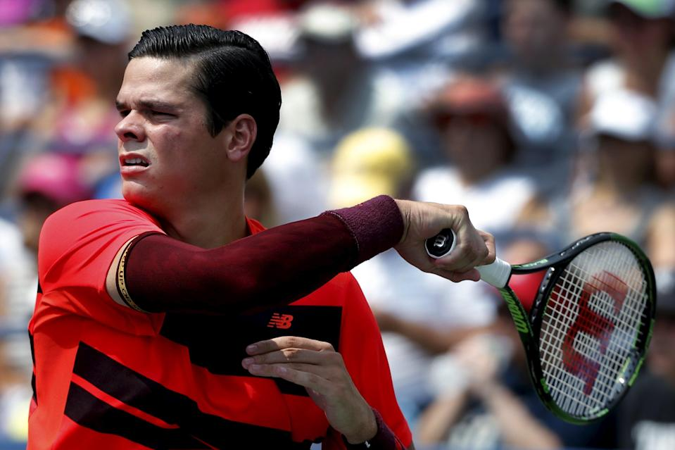 Milos Raonic of Canada hits a return to Fernando Verdasco of Spain during their match at the U.S. Open Championships tennis tournament in New York, September 2, 2015. REUTERS/Mike Segar