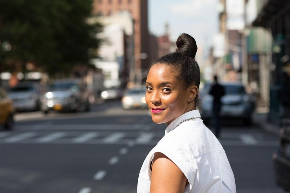 """When it creeps past 80 degrees, there's nothing like a super-sleek topknot. To keep it things smooth, Marjan recommends adding a generous amount of hairspray at your roots. """"This helps control your hair and gives it a sleek and shiny finish when you brush it through,"""" she says. """"I like <a href=""""https://shop-links.co/1709285568310602278"""" rel=""""nofollow noopener"""" target=""""_blank"""" data-ylk=""""slk:Tresemmé Micro Mist Extend Hairspray"""" class=""""link rapid-noclick-resp"""">Tresemmé Micro Mist Extend Hairspray</a> because it's light enough to provide hold without leaving your hair stiff or crunchy. It's also helpful to use a <a href=""""https://shop-links.co/1709285601872413330"""" rel=""""nofollow noopener"""" target=""""_blank"""" data-ylk=""""slk:smoothing brush"""" class=""""link rapid-noclick-resp"""">smoothing brush</a> to gather your hair."""""""