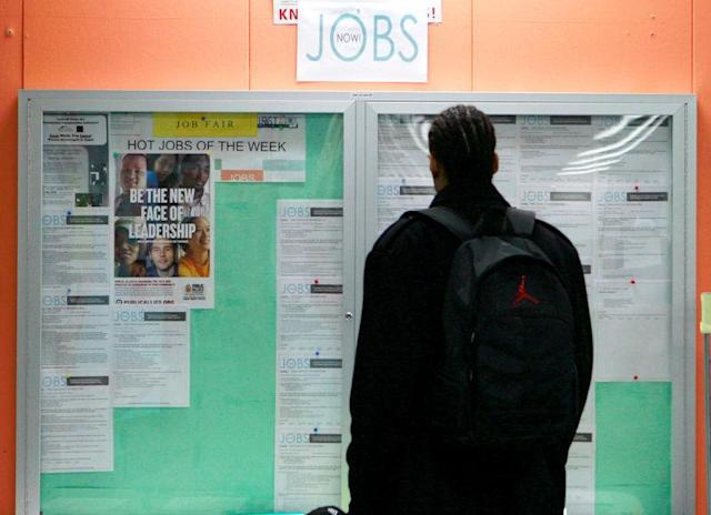 FILE PHOTO: A man looks over employment opportunities at a jobs center in San Francisco, California, U.S, February 4, 2010. REUTERS/Robert Galbraith/File Photo