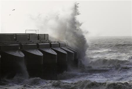 Waves crash over the marina wall in Brighton, in southern England January 7, 2014. REUTERS/Luke MacGregor