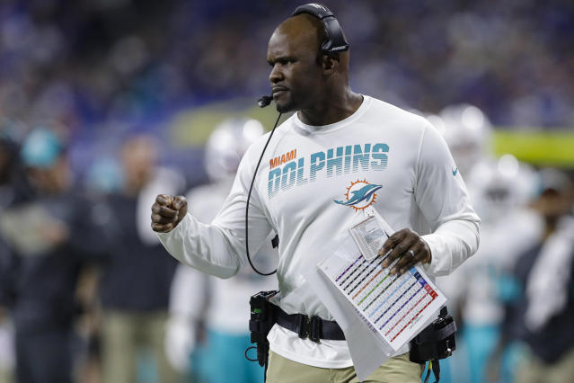 FILE - In this Nov. 10, 2019, file photo, Miami Dolphins head coach Brian Flores watches from the sidelines during the first half of an NFL football game against the Indianapolis Colts in Indianapolis. Pro football is discovering that the spirit of the Rooney Rule is being violated. NFL Commissioner Roger Goodell made that a point of emphasis in his state of the league speech during Super Bowl week. So count on Goodell finding ways to more strongly implement the policy that requires teams to interview minority candidates for coaching and executive positions.(AP Photo/Darron Cummings, File)