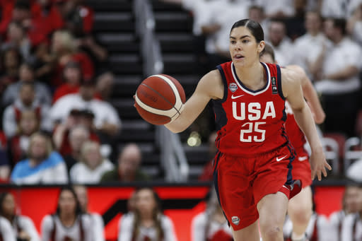 FILE - In this Feb. 2, 2020, file photo, USA Women's National Team guard Kelsey Plum drives the ball upcourt during an NCAA women's exhibition basketball game against Louisville in Louisville, Ky. USA Basketball will have a team of WNBA players available to qualify in 3-on-3 for the Olympics. Plum, Allisha Gray, Katie Lou Samuelson and Stefanie Dolson headline the 11 players invited to a training camp this week in Chicago. (AP Photo/Wade Payne, File)