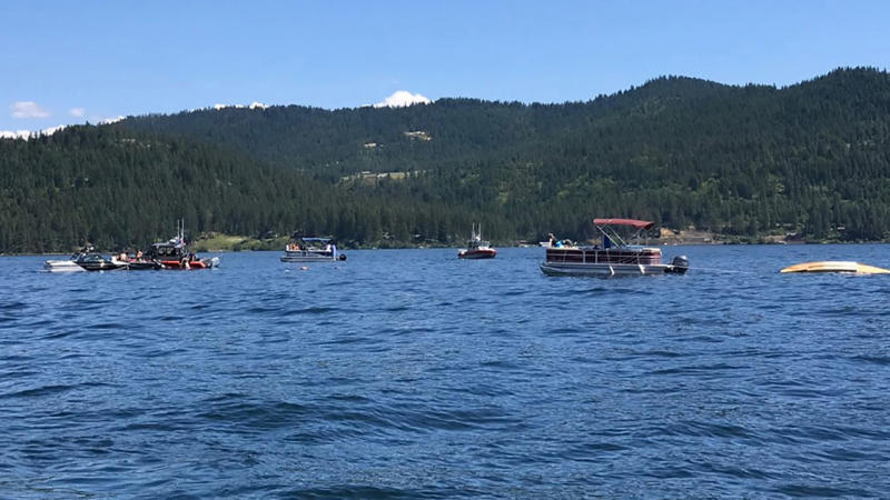 Boaters, pictured here flagging down authorities to the crashed planes on Lake Coeur d'Alene.