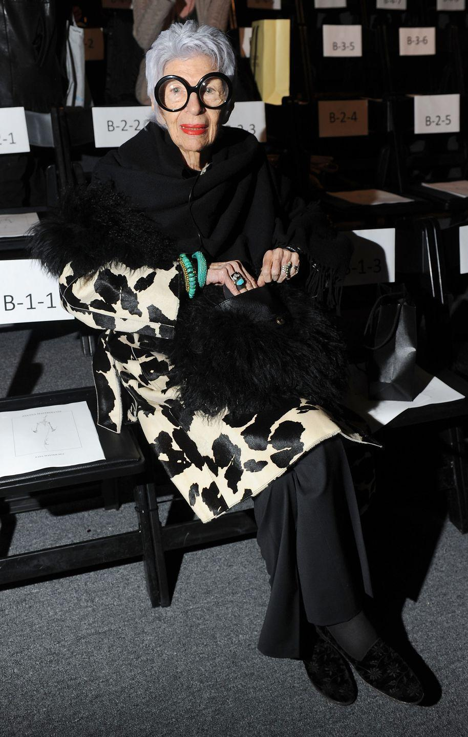 <p>Iris is photographed sitting front row at the Joanna Mastroianni fall fashion show in New York City wearing a spotted black-and-white coat and turquoise jewelry.<br></p>