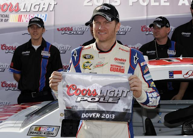 Dale Earnhardt Jr. poses with the pole award after qualifying for Sunday's NASCAR Sprint Cup series auto race, Friday, Sept. 27, 2013, at Dover International Speedway in Dover, Del. (AP Photo/Nick Wass)