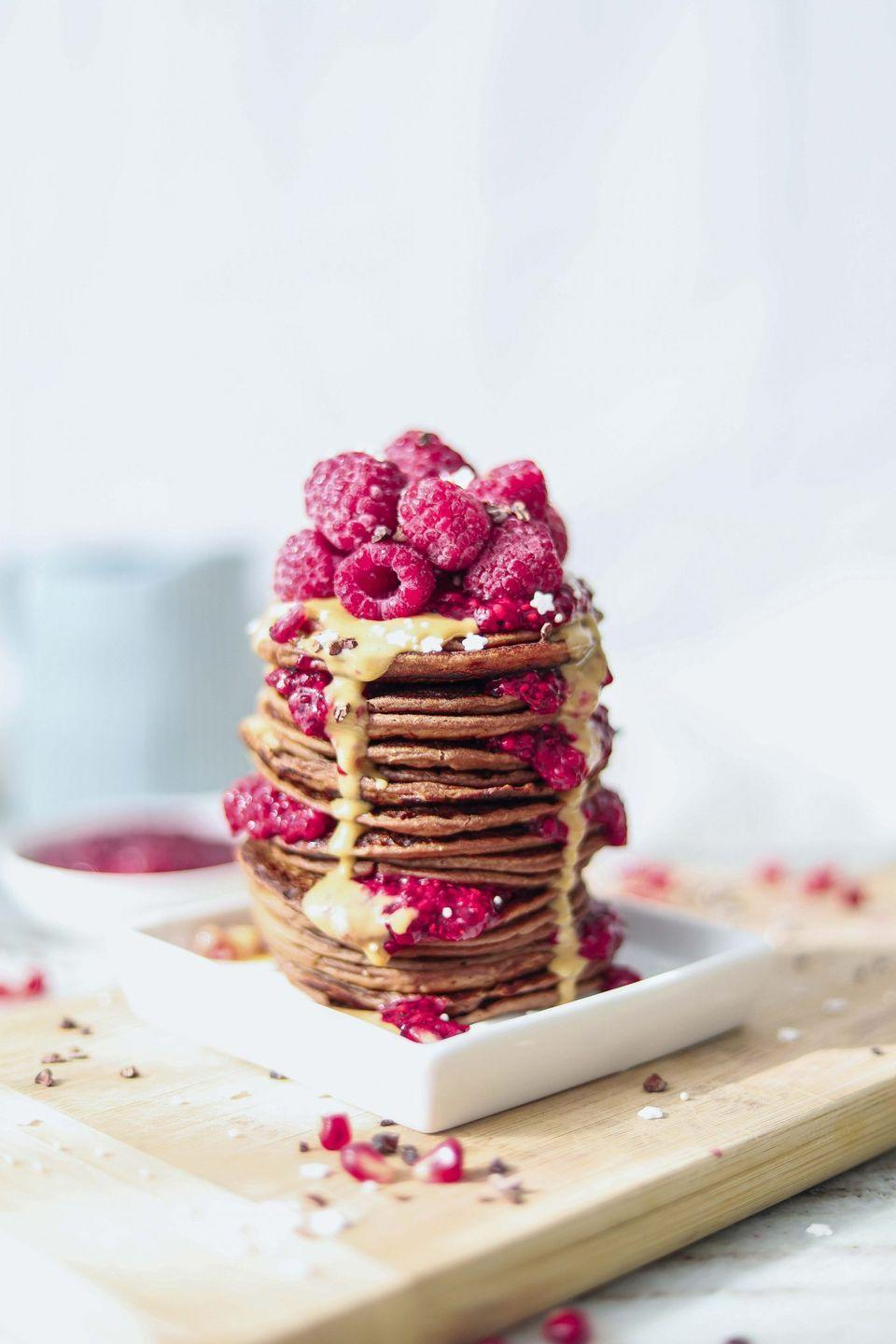 """<p>Fresh, juicy raspberries? Check. Healthy fat-packed chia seeds for added crunch? Check. Moist, vegan-friendly pancakes? Triple check. This is a recipe for success.</p><p>Try the recipe for yourself: <a class=""""link rapid-noclick-resp"""" href=""""https://www.twospoons.ca/recipe/healthy-vegan-protein-pancakes/"""" rel=""""nofollow noopener"""" target=""""_blank"""" data-ylk=""""slk:twospoons.ca"""">twospoons.ca</a></p>"""