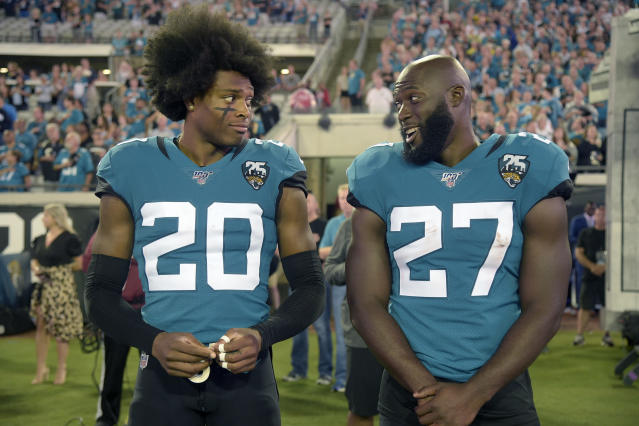Jacksonville Jaguars cornerback Jalen Ramsey (20) talks to running back Leonard Fournette (27) before an NFL football game against the Tennessee Titans Thursday, Sept. 19, 2019, in Jacksonville, Fla. (AP Photo/Phelan M. Ebenhack)