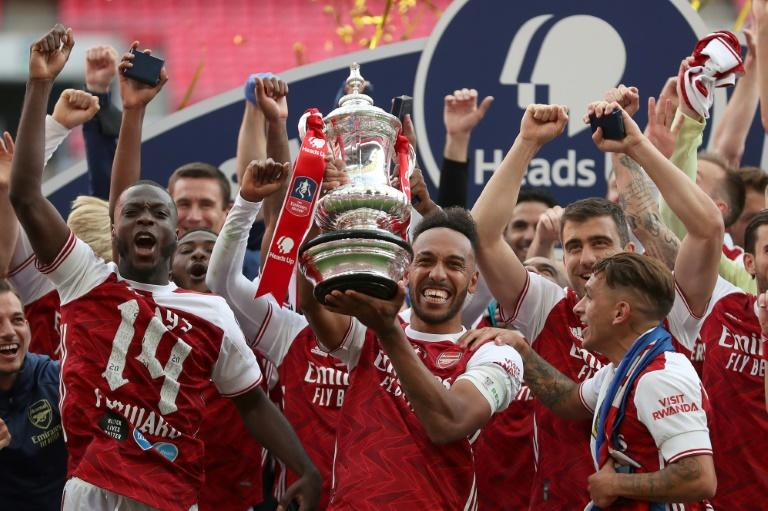 Pierre-Emerick Aubameyang lifts the FA Cup after scoring twice against Chelsea