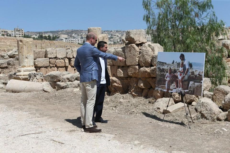 Jordan: William and Crown Prince Hussein of Jordan look at a photo of the Duchess when she was photographed with her family at the same spot (PA)