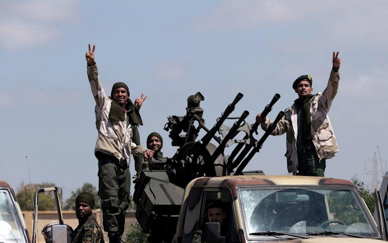 Fighters from Khalifa Haftar's Libyan National Army seen leaving Benghazi to reinforce troops advancing on Libya - REUTERS