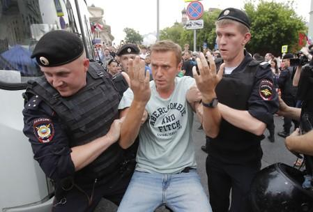 Russian police detain opposition politician Alexei Navalny at protest