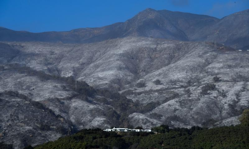 A house remains standing in front of an ash-filled hillside in Montecito, California, on Dec. 20. (FREDERIC J. BROWN via Getty Images)