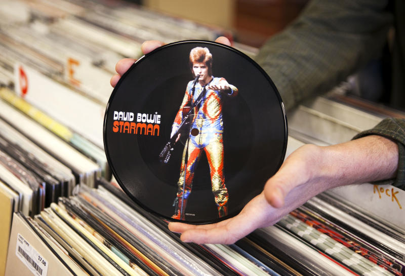 """A copy of David Bowie's """"Starman"""" record is seen, Thursday, April 19, 2012, in Scarborough, Maine. The seven-inch vinyl record is being released for Record Store Day on Saturday, April 21. (AP Photo/Robert F. Bukaty)"""