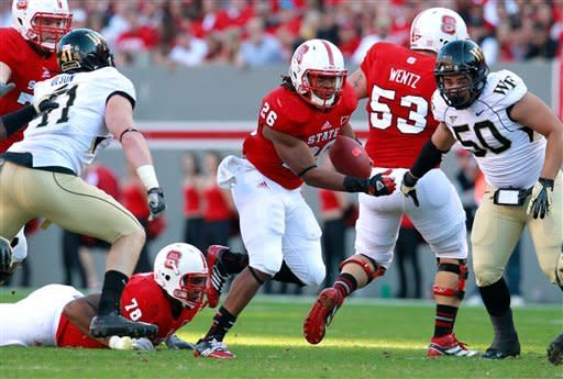 North Carolina State running back Tony Creecy (26) looks for running room against the Wake Forest defense during the first half of their NCAA college football game, Saturday, Nov. 10, 2012, in Raleigh, N.C. (AP Photo/The News & Observer, Ethan Hyman)