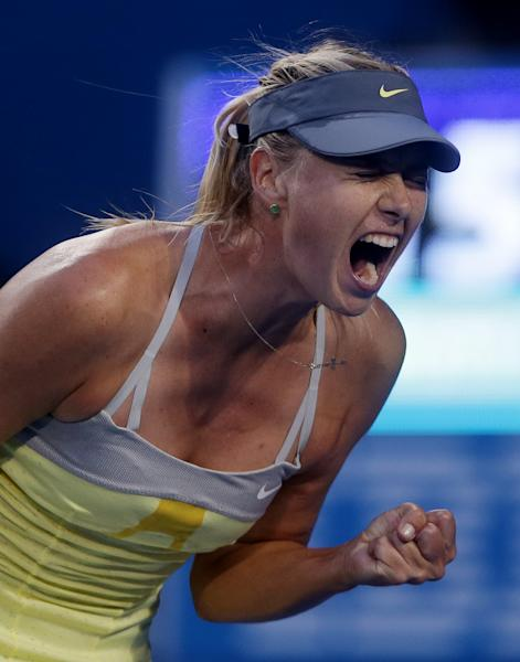 Russia's Maria Sharapova reacts during her third round match against Venus Williams of the US at the Australian Open tennis championship in Melbourne, Australia, Friday, Jan. 18, 2013. (AP Photo/Dita Alangkara)